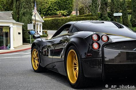 pagani zonda gold pagani huayra carbon gold stripes red black interior