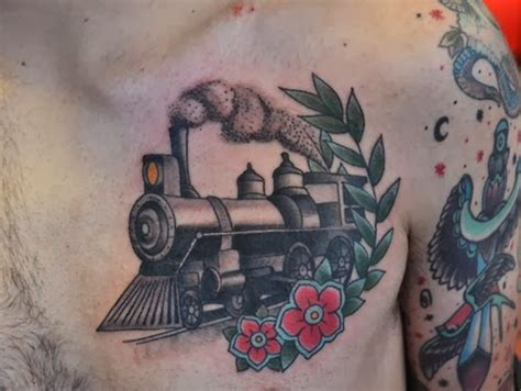steam train tattoo designs school style colored chest of steam with