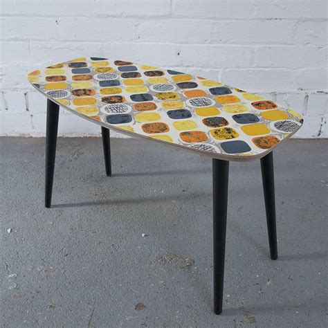 vintage fabric coffee table in yellow spot by winter s
