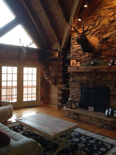 rustic living room hunting trophies elk mount log cabin