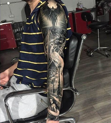fallen angel tattoo kissimmee yallzee s awesome angel tattoos inked magazine tatts
