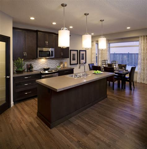 what color wood floor with dark cabinets new home model orleans 2 in walden calgary by cardel homes