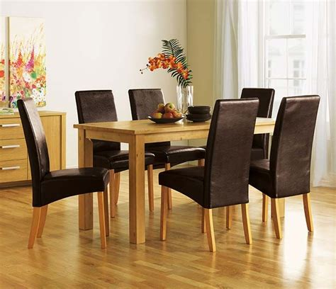 wooden table leather chairs 1000 ideas about black dining room sets on