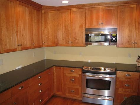uba tuba granite with oak cabinets 65 best hickory cabinets and images on pinterest