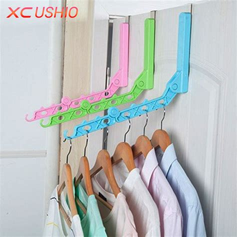 Magic Hanger Clothes Organiser Isi 8 Gantungan Baju Hemat Ruang door hanging foldable clothes hanger magic 5 hanger rack with hook space save clothing tie
