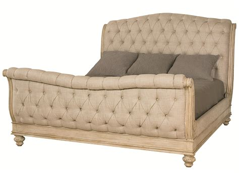 king sleigh bed with linen tufted headboard and footboard