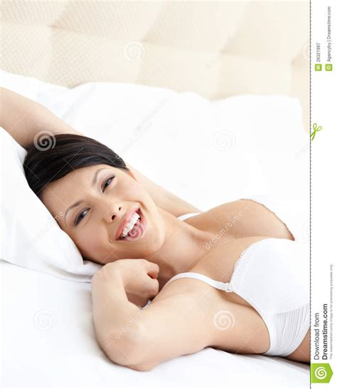 i was comfortable woman in underwear is lying in the comfortable bed stock