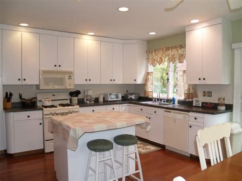 refinish laminate kitchen cabinets paint quot euro style quot laminate cabinets and add hardware