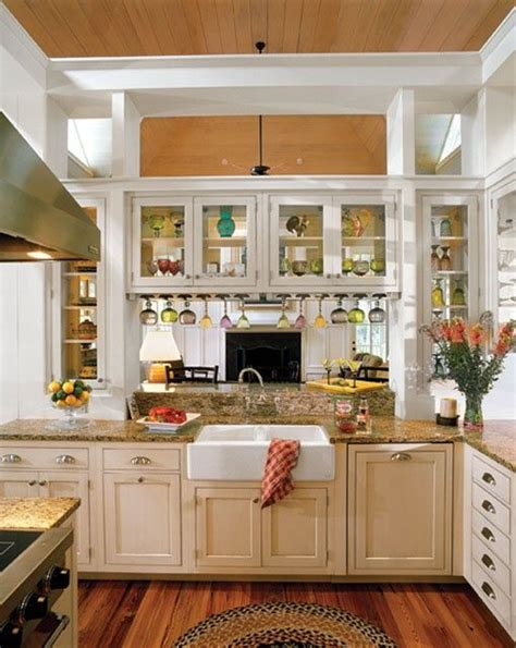 Kitchen Cabinets With Glass Doors On Both Sides by Large Opening From Kitchen Into Family Room With Glass