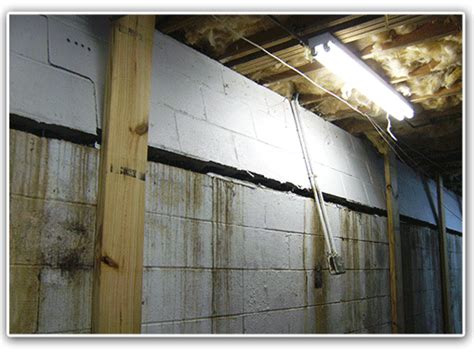 bowed basement wall repair jes foundation repair