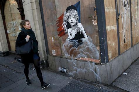 banksy mural  les mis girl  tears takes  frances