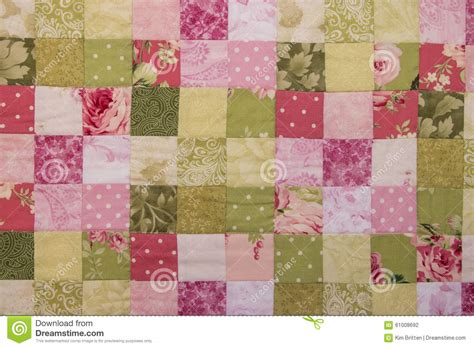 Patchwork Photo Quilt - a colorful patchwork quilt stock photo image of fabric