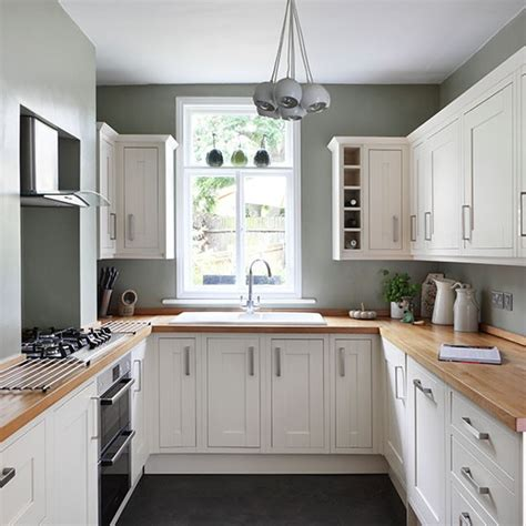 white and green country kitchen small kitchen