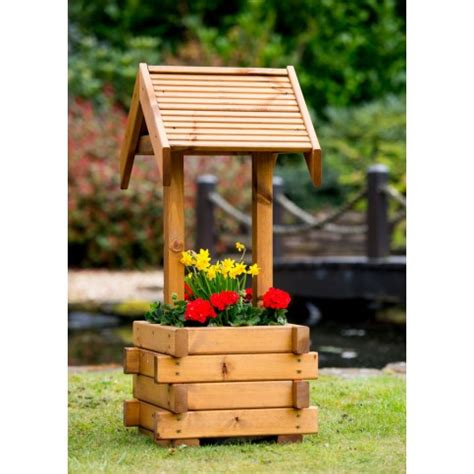 small wooden wishing well planter