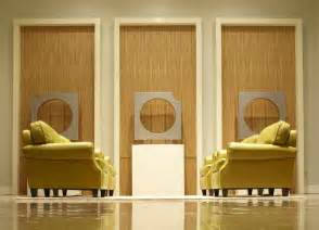 Wall covering ideas with yellow chairs interior design