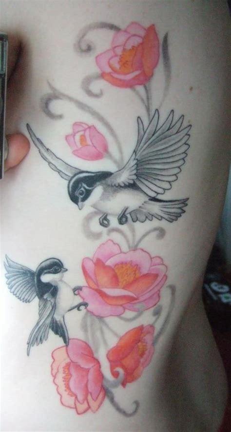 tattoo flower into birds pretty black gray birds with colored flowers tattoo