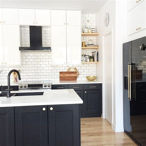 kitchen with black appliances and white kitchenskils