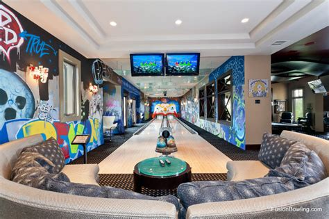 this archetypical 50 s rec room basement features the home bowling alley for new york yankee baseball player s