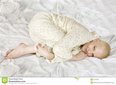 lying on the bed thoughtful blond bald woman lying on the bed stock photography image 9170732