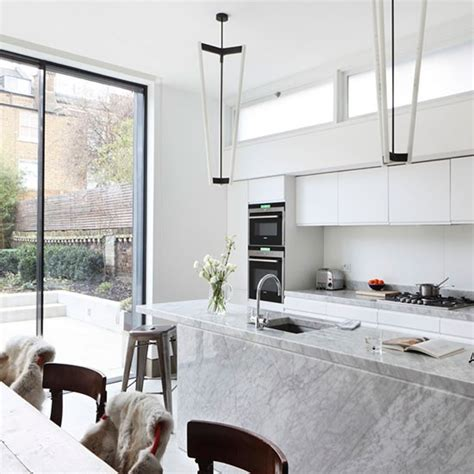 white marble kitchen with grey island house home white kitchen with grey marble island kitchen diner