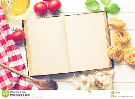 four ingredient cookbook books blank recipe book and fresh ingredients stock photo