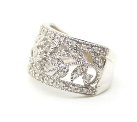 14k white gold wide band ring with cut diamonds