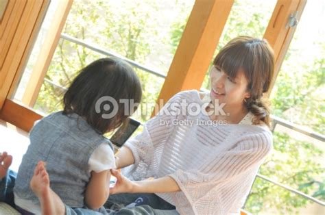 mom and son have in livingroom mother and son sitting at living room stock photo thinkstock