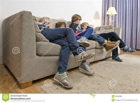 4 on a couch game bored children gaming on a couch stock photo image 53222860