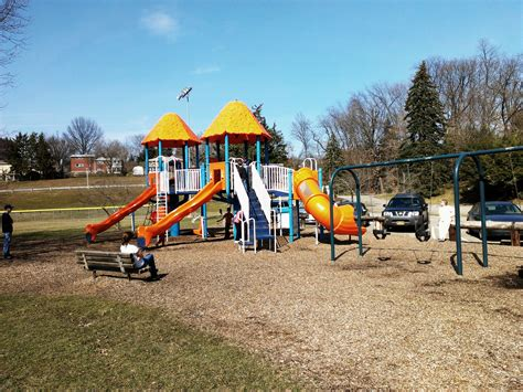 park with swings file swings and playground equipment in kiwanis park jpeg
