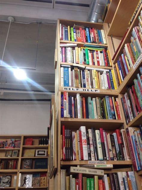 bookstore s self help shelf is high to reach by