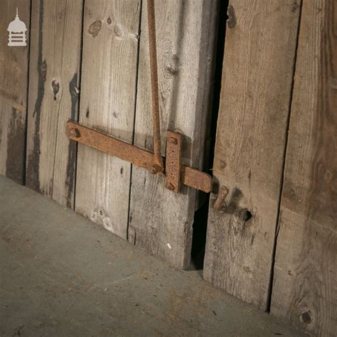 Pair of Reclaimed Pine Ledged and Braced Barn Doors with