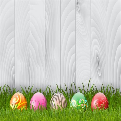 easter images free decorative easter eggs in grass on a wood background