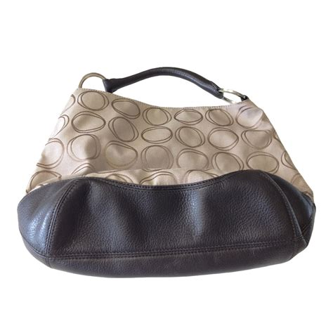 oroton canvas monogrammed hobo  chocolate leather base