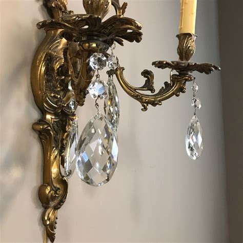 pair antique louis xv brass crystal wall sconces