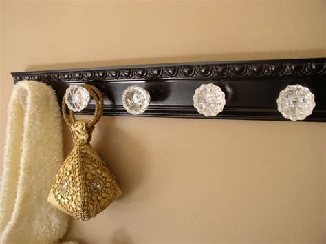 black coat rack with 5 glass knobs 26