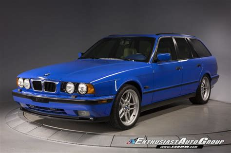stunning santorini blue e34 bmw m5 touring is expensive