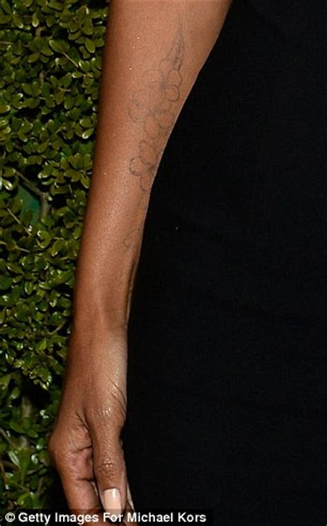 new tattoo feels tight halle berry puts her budding bump on show and new floral
