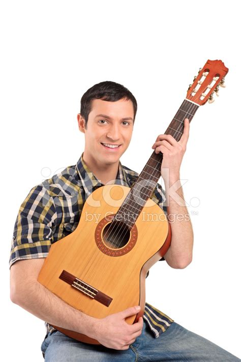how to play boat drinks on guitar young man playing acoustic guitar stock photos
