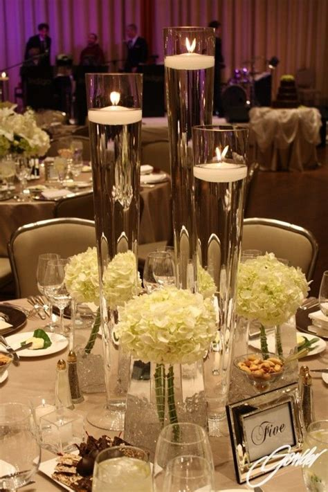 vases with floating candles embellished with white
