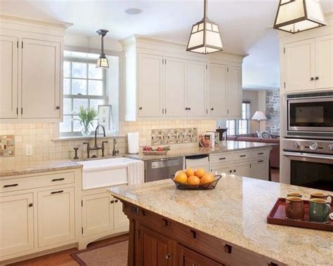 white kitchen cabinets with visible hinges craftsman kitchen love these cabinet doors that sit flush