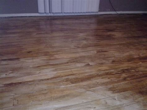 Stained concrete floor downstairs   looks like wood