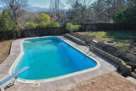 backyard pool on a hill search outdoors