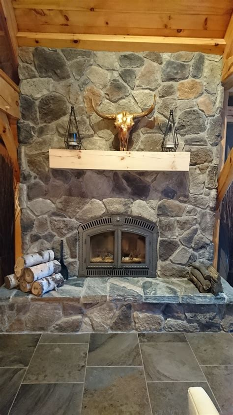 fireplace veneer installation veneer fireplace in a horseshoe valley home adds