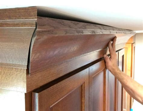 how to install crown molding on top of kitchen cabinets hiding a wavy ceiling in crown molding homebuilding