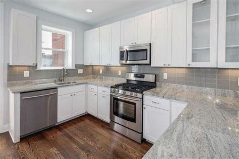 white kitchen cabinets with quartz countertops quartz countertops with white cabinets door