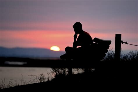 lonely man on bench lonely man sitting on bench at sunset free stock photos in