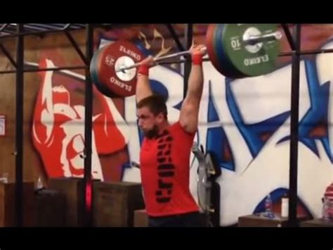 dmitry klokov bench press 452 lb 205 kg strict overhead press seated igor p