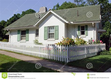 Two Story Pole Barn by Cottage With Picket Fence Royalty Free Stock Images