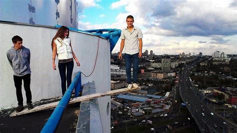 photos of defying aerial daredevil hanging
