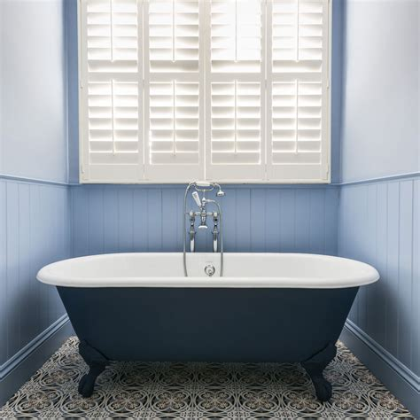 roll top bathrooms traditional bathroom with blue roll top bath and shuttered